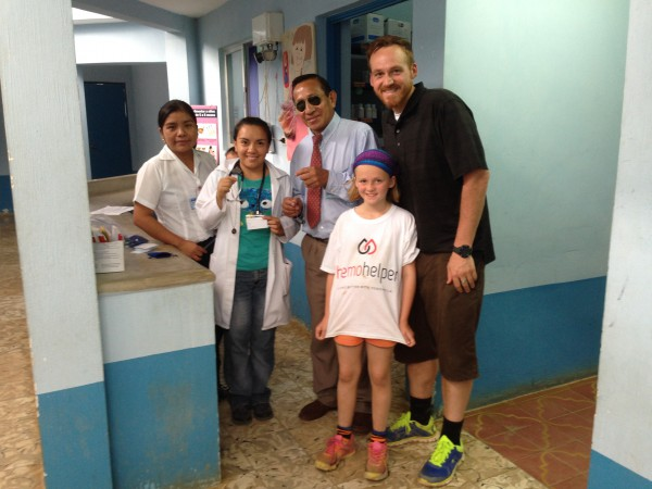 HemoHelpers Adam and Olivia deliver a donation of bleeding disorder medical identification cards and necklaces to a remote medical clinic in Guatemala.
