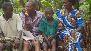 Wassawa, Agnes' nephew with hemophilia, sitting with other family members.